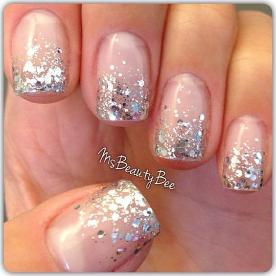 Photo of silver glitter dipped nails