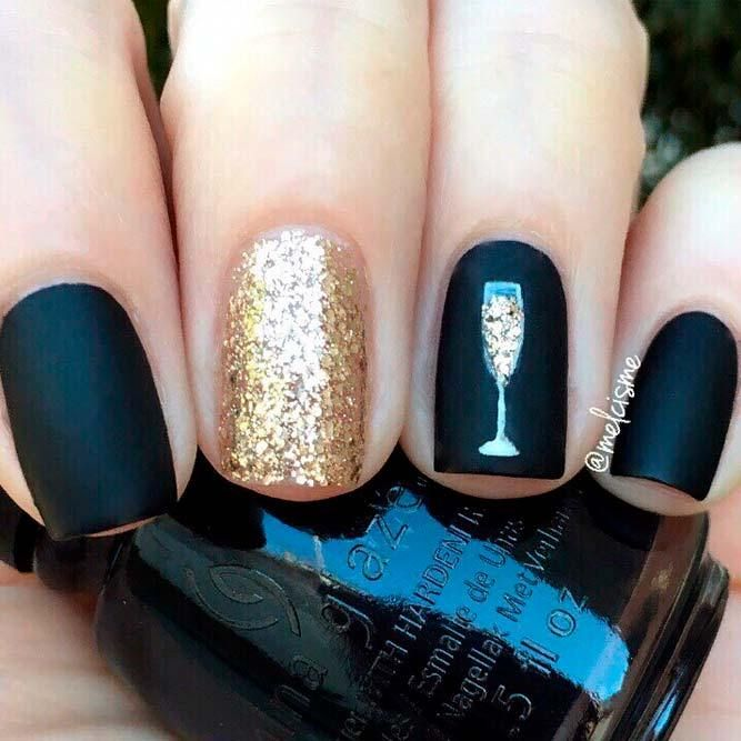 Photo of black and gold nails with accent champagne glass