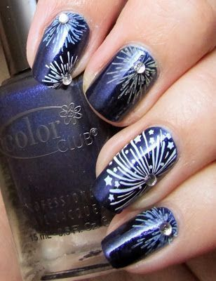 Photo of navy blue nails with white fireworks and stars