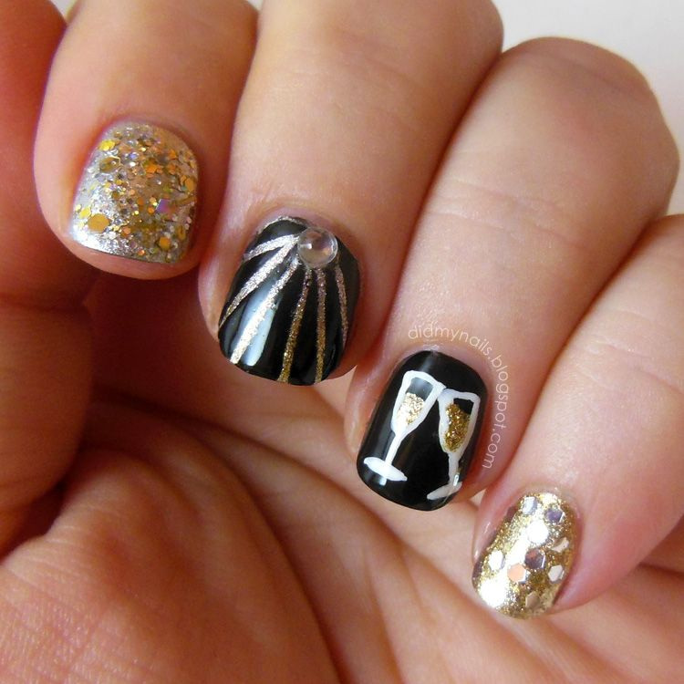 Photo of black and gold nails with glitter and champagne glasses
