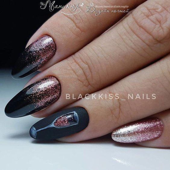 Photo of black nails with rose gold accent glitter and champagne glass for new years nail art designs 2020