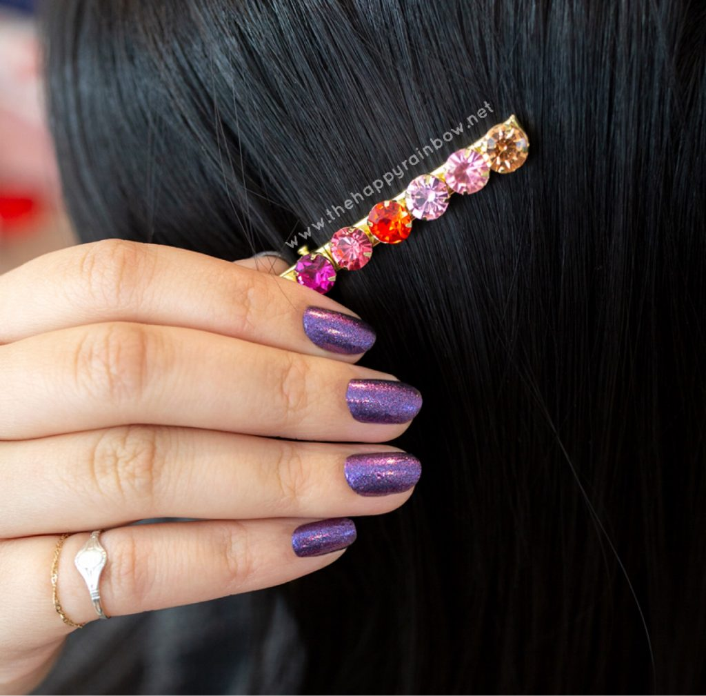 Image of Cosmic Cloud Color Street on real nails with hair clip.