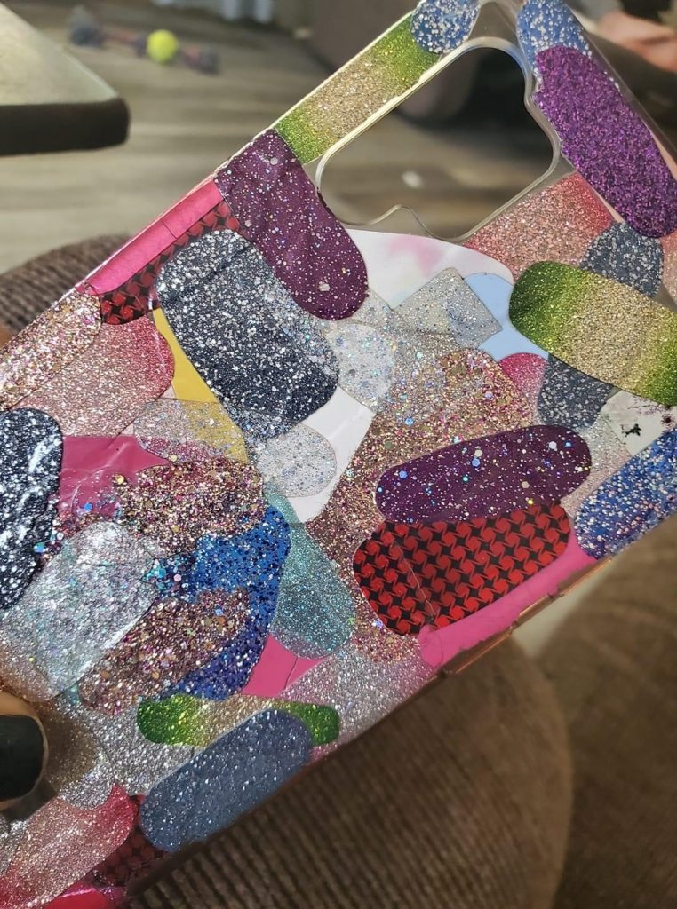 Image of cell phone case with old nail polish strips on it